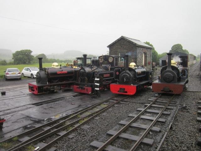 Hugh Napier, Marchllyn, Gwynedd and Winifred lined up in the yard at Llanuwchllyn
